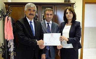 Ulaş Belediye Başkanı Turan İlbey, mazbatasını aldı